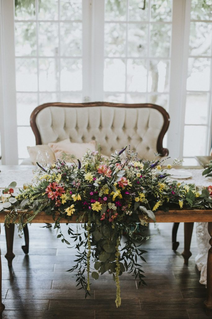 panache style sweetheart table wildflower centerpiece